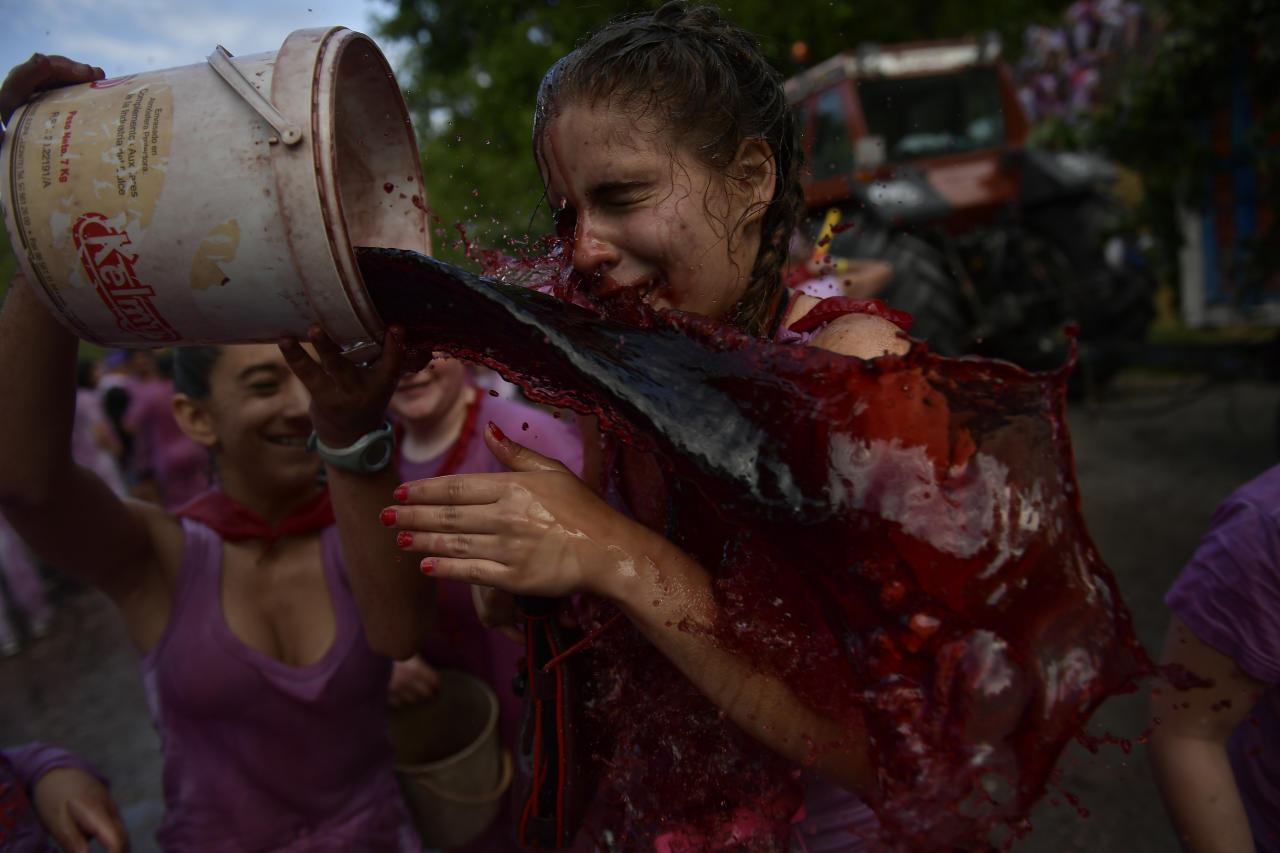 <p>A female is doused with wine as people take part in a wine battle, in the small village of Haro, northern Spain, Friday, June 29, 2018. (Photo: Alvaro Barrientos/AP) </p>
