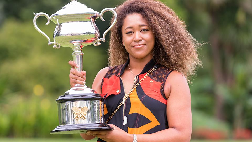 Naomi Osaka, pictured here with the Daphne Akhurst Memorial Trophy after winning the Australian Open.