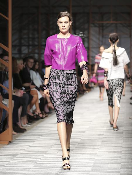 FILE - In this Sept. 22, 2013 file photo, a model wears a creation for Missoni women's Spring-Summer 2014 collection, part of the Milan Fashion Week, unveiled in Milan, Italy. Orchid is growing on us: A version of the purple hue is Pantone Inc.'s color of the year for 2014. (AP Photo/Antonio Calanni, File)