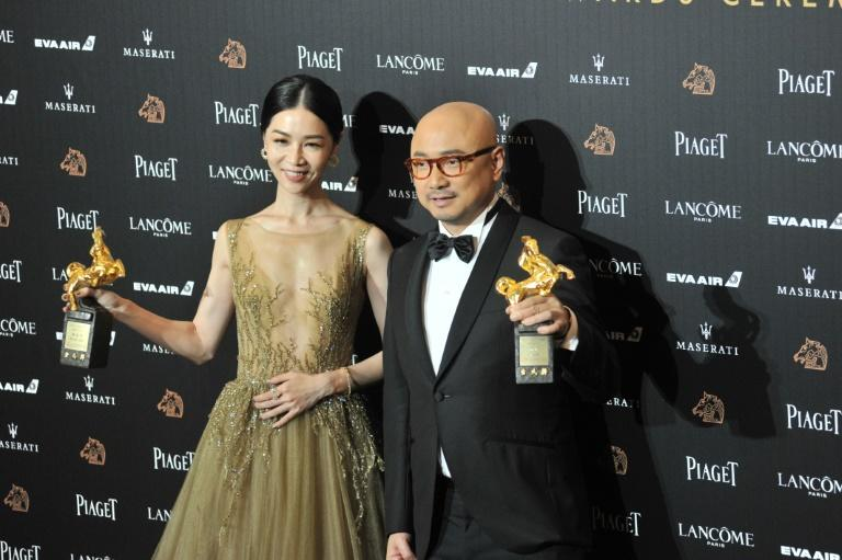 Taiwan's theatre veteran Hsieh Ying-xuan (L) beat better-known Chinese rivals to claim best actress with her first movie 'Dear EX'