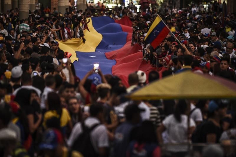 Tens of thousands have protested across Venezuela in rival demonstrations for and against Maduro (AFP Photo/JOAQUIN SARMIENTO)