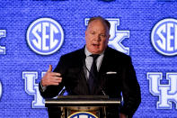 Kentucky head coach Mark Stoops speaks to reporters during the NCAA college football Southeastern Conference Media Days Tuesday, July 20, 2021, in Hoover, Ala. (AP Photo/Butch Dill)