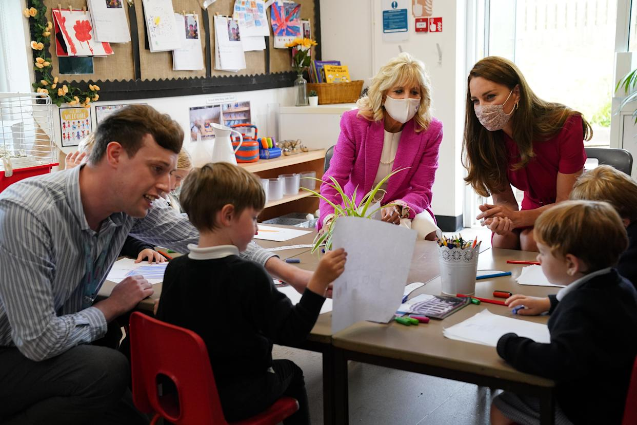 HAYLE, UNITED KINGDOM - JUNE 11: U.S. First Lady Dr Jill Biden (L) and Catherine, Duchess of Cambridge talk with children in the schools Reception Class during a visit to Connor Downs Academy, during the G7 summit in Cornwall on June 11, 2021 in Hayle, west Cornwall, England. (Photo by Aaron Chown/WPA Pool/Getty Images)
