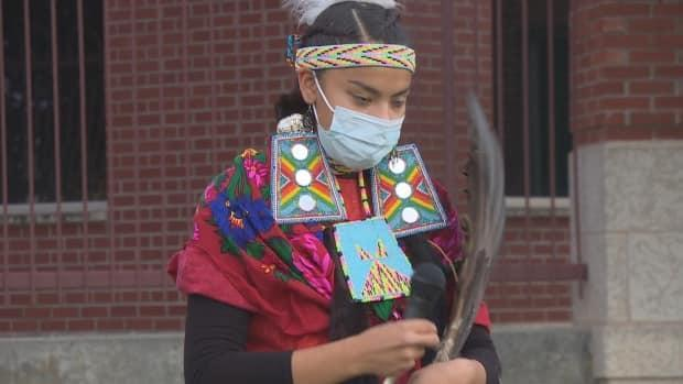 Meadow Musqua, 17, has been doing healing dances outside a Regina hospital for her kokum, Lorna Standingready, who has been diagnosed with COVID-19. (Richard Agecoutay/CBC - image credit)