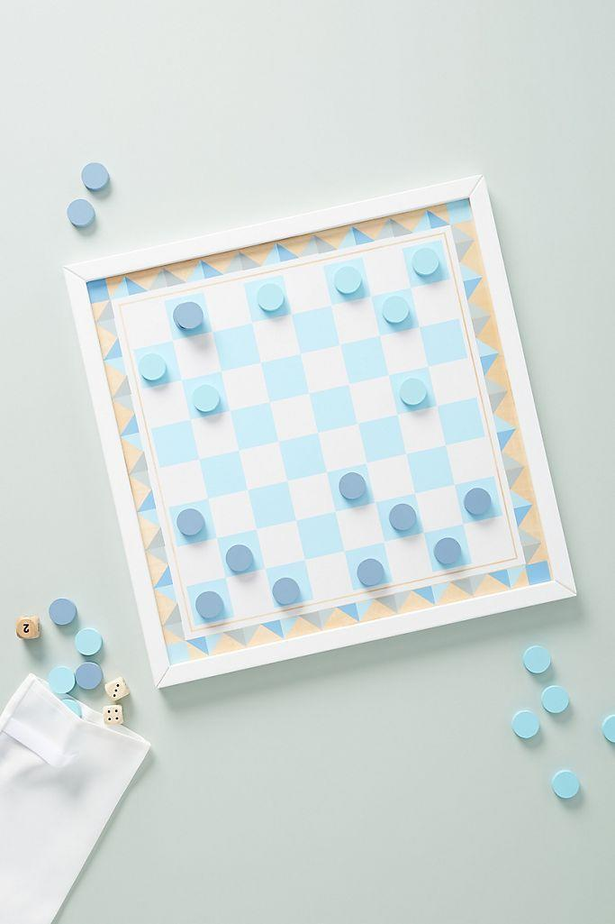 """<p><strong>Melissa & Doug</strong></p><p>anthropologie.com</p><p><strong>$34.00</strong></p><p><a href=""""https://go.redirectingat.com?id=74968X1596630&url=https%3A%2F%2Fwww.anthropologie.com%2Fshop%2Fbackgammon-checkers-game-board&sref=https%3A%2F%2Fwww.countryliving.com%2Fshopping%2Fgifts%2Fg2077%2Fchristmas-presents%2F"""" rel=""""nofollow noopener"""" target=""""_blank"""" data-ylk=""""slk:Shop Now"""" class=""""link rapid-noclick-resp"""">Shop Now</a></p><p>Game night has never been chicer with this double-sided game board.</p>"""