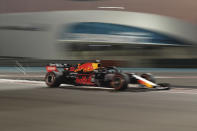 Red Bull driver Max Verstappen of the Netherland's steers his car during the second free practice at the Yas Marina racetrack in Abu Dhabi, United Arab Emirates, Friday, Nov. 29, 2019. The Emirates Formula One Grand Prix will take place on Sunday. (AP Photo/Hassan Ammar)