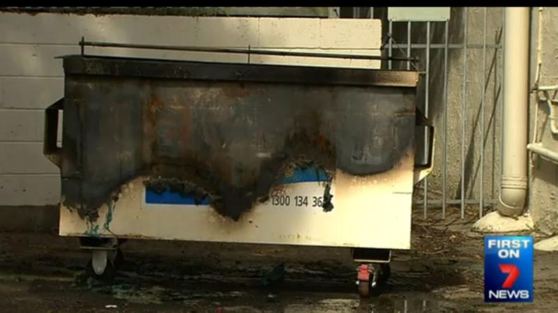 Police allege the woman also set fire to a dumpster in a nearby alleyway. Photo: 7 News