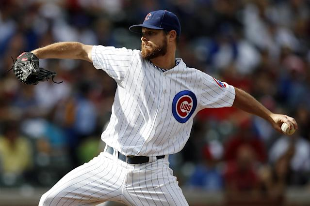 Chicago Cubs starting pitcher Travis Wood delivers against the Atlanta Braves during the first inning of a baseball game on Saturday, Sept. 21, 2013, in Chicago. (AP Photo/Andrew A. Nelles)
