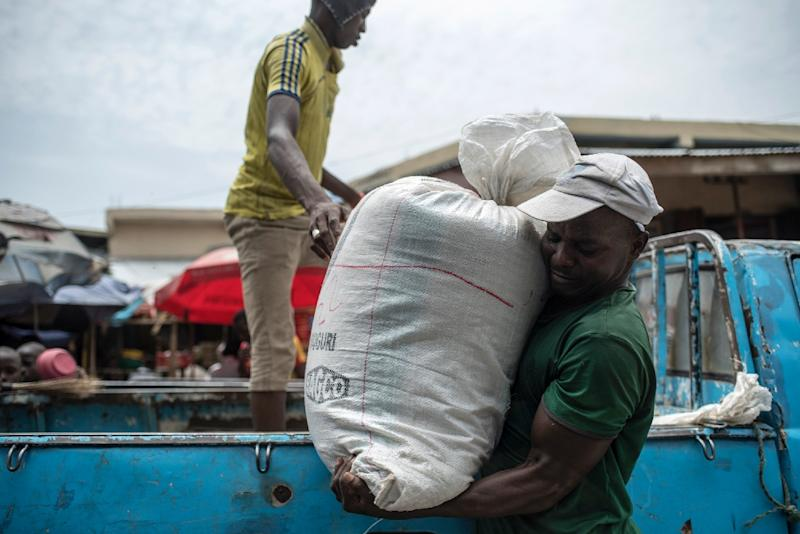 The proposed minimum wage would still only pay for three big bags of rice (AFP Photo/STEFAN HEUNIS)