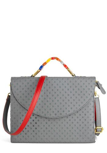 """<div class=""""caption-credit""""> Photo by: ModCloth</div><div class=""""caption-title""""></div><b>Messenger Bag <br></b> Messenger bags are usually my go-to bag. They hold a ton and you can wear one across your body to free up both hands! Plus, they look way more stylish than a backpack! <br> <a rel=""""nofollow"""" href=""""http://blogs.babble.com/family-style/2012/11/12/7-handbags-every-woman-must-own/#messenger-bag"""" target=""""""""><i>Get it here</i></a> <br>"""