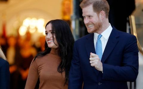 Harry and Meghan, Duchess of Sussex leave after visiting Canada House in London after their recent stay in Canada. - Credit: AP