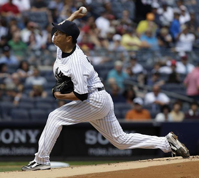 New York Yankees starting pitcher Hiroki Kuroda throws during the first inning of the baseball game against the Boston Red Sox at Yankee Stadium, Sunday, Sept. 8, 2013, in New York. (AP Photo/Seth Wenig)