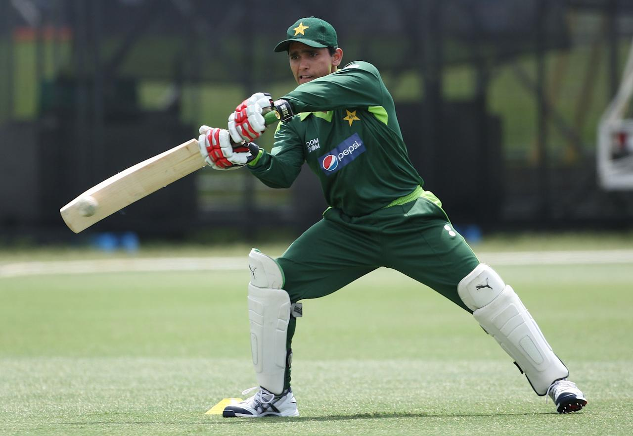 AUCKLAND, NEW ZEALAND - DECEMBER 21:  Adnan Akmal bats during a Pakistan training session at Colin Maiden Park on December 21, 2010 in Auckland, New Zealand.  (Photo by Sandra Mu/Getty Images)