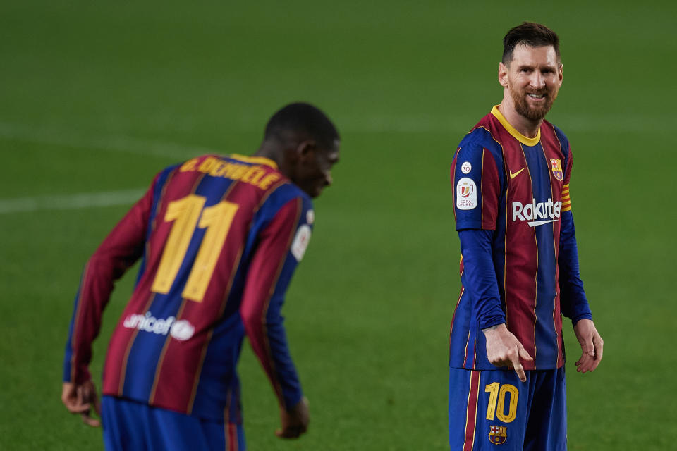 Lionel Messi of Barcelona looks to Ousmane Dembele during the Copa del Rey Semi Final Second Leg match between FC Barcelona and Sevilla at Camp Nou on March 3, 2021 in Barcelona, Spain. Sporting stadiums around Spain remain under strict restrictions due to the Coronavirus Pandemic as Government social distancing laws prohibit fans inside venues resulting in games being played behind closed doors. (Photo by Jose Breton/Pics Action/NurPhoto via Getty Images)