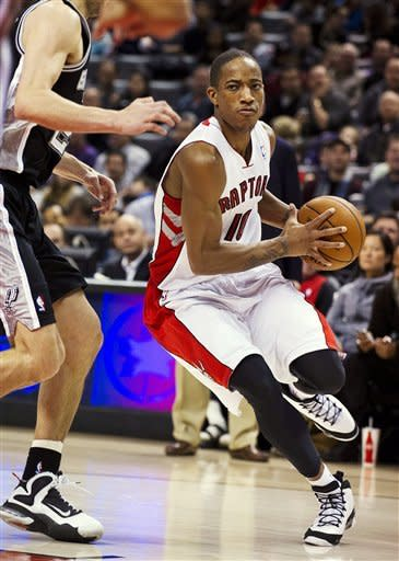 Toronto Raptors' DeMar DeRozan drives to the basket against the San Antonio Spurs during the first half of an NBA basketball game, Sunday, Nov. 25, 2012, in Toronto. (AP Photo/The Canadian Press, Aaron Vincent Elkaim)