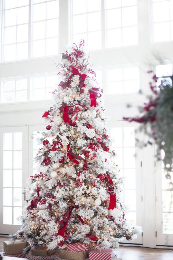 "<p>Red is the perfect hue to contrast with a snowy tree, as proven by this winter wonderland Christmas tree from <a href=""http://www.stylemepretty.com/vault/image/2359302"" rel=""nofollow noopener"" target=""_blank"" data-ylk=""slk:Style Me Pretty"" class=""link rapid-noclick-resp"">Style Me Pretty</a> that is dotted with red berries, bows, and ornaments. </p>"