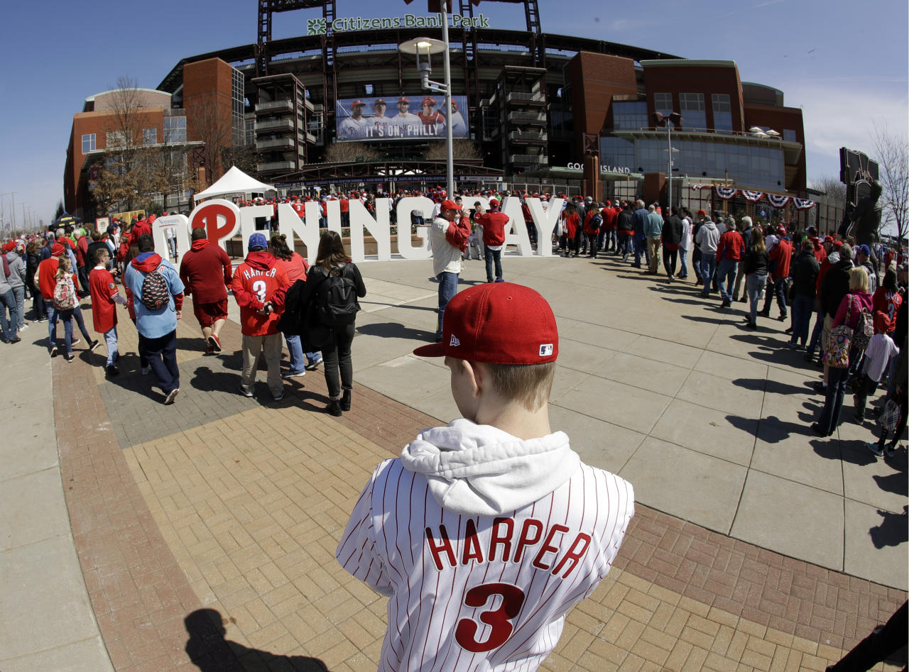 A fan wears a Bryce Harper jersey as other fans gather for the Philadelphia Phillies Opening Day baseball game against the Atlanta Braves at Citizens Bank Park in Philadelphia, March 28, 2019. (Photo: Matt Rourke/AP)