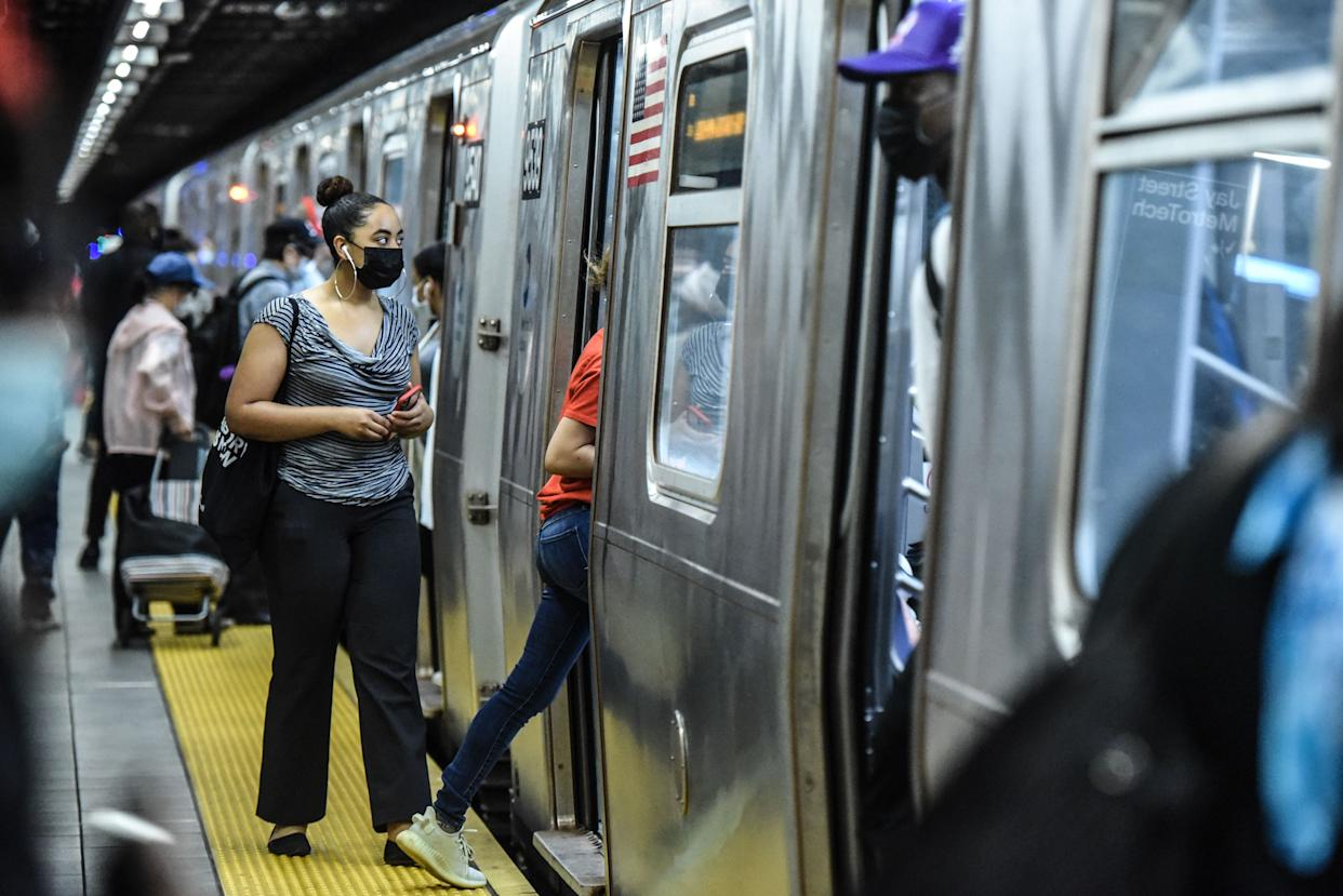 People commute on the subway in the Brooklyn borough on June 22, 2020 in New York City. New York City enters phase 2 reopening and the city estimates as many as 400,000 people will return to work next month as coronavirus restrictions are lifted.