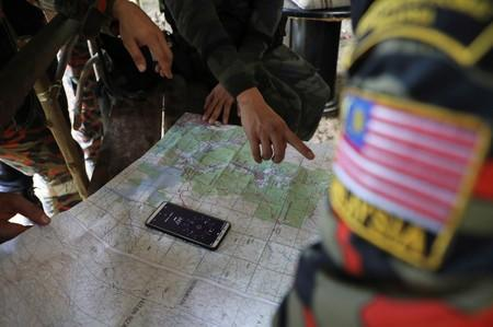 Members of Malaysian rescue team look at a map during a search and rescue operation for 15-year-old Irish girl Nora Anne Quoirin who went missing from a resort in Seremban.