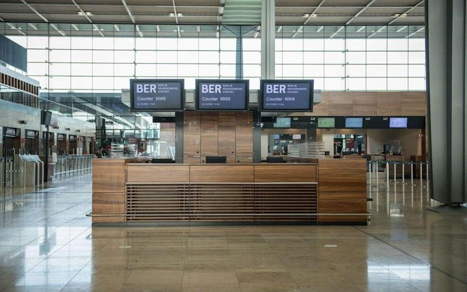 An empty counter at the new BER airport in Berlin, which was designed to see 20 million passengers a year pass through it - Getty Images