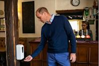 Britain's Prince William got into the spirit by having his picture taken sipping a glass of cider and dutifully using hand sanitizer