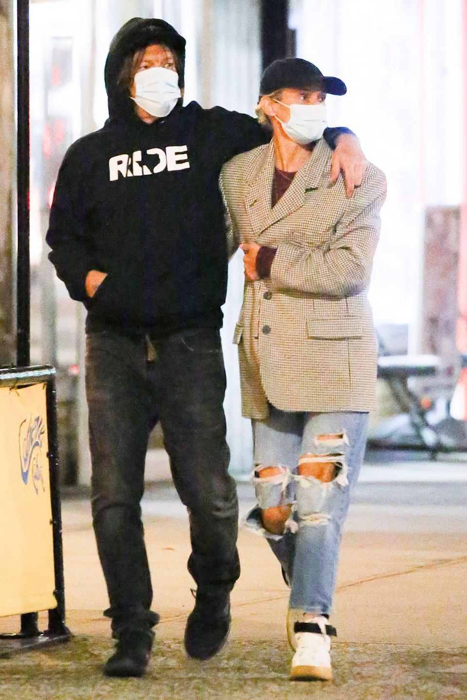 <p>Norman Reedus and Diane Kruger fly under the radar during a walk through N.Y.C. on Sunday.</p>
