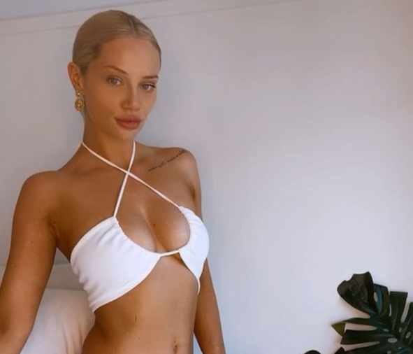 Jessika Power wearing a white bikini top