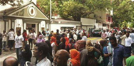 Supporters of former Maldives president Mohamed Nasheed wait for his arrival at the Indian High Commission in Male February 13, 2013. REUTERS/Stringer