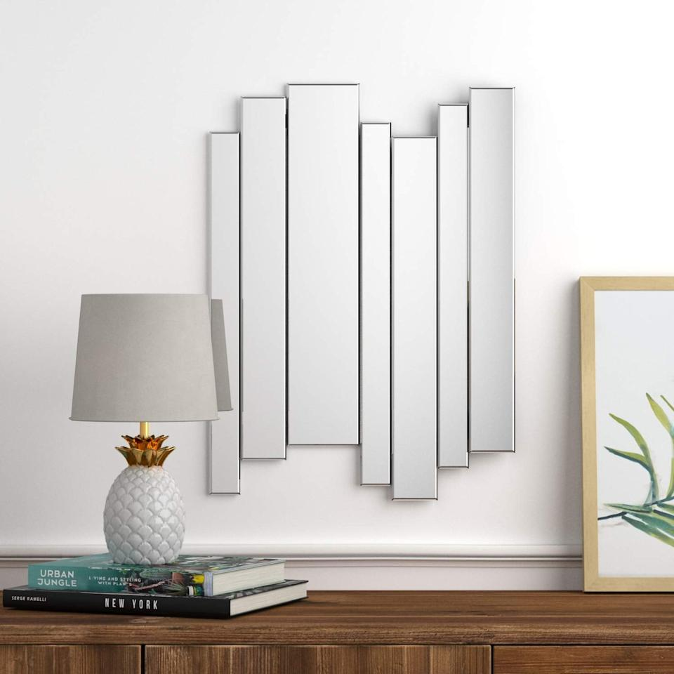 "<p>Looking for something modern? Try this <a href=""https://www.popsugar.com/buy/Rivet%20Glass%20Mirror-449570?p_name=Rivet%20Glass%20Mirror&retailer=amazon.com&price=18&evar1=casa%3Aus&evar9=46178542&evar98=https%3A%2F%2Fwww.popsugar.com%2Fhome%2Fphoto-gallery%2F46178542%2Fimage%2F46178866%2FRivet-Modern-Glass-Mirror&list1=amazon%2Cmirrors%2Cshoppping%2Chome%20shopping&prop13=api&pdata=1"" rel=""nofollow"" data-shoppable-link=""1"" target=""_blank"">Rivet Glass Mirror</a> ($18).</p>"
