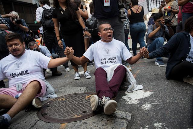 <p>Immigration activists protesting the Trump administration's decision on the Deferred Action for Childhood Arrivals program sit in the street and block traffic on 5th Avenue near Trump Tower, September 5, 2017. (Photo: Drew Angerer/Getty Images) </p>