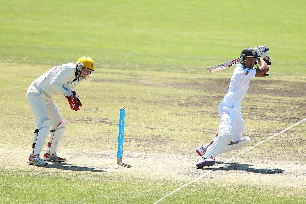 CANBERRA, AUSTRALIA - DECEMBER 08:  Dinesh Chandimal of Sri Lanka bats during day three of the international tour match between the Chairman's XI and Sri Lanka at Manuka Oval on December 8, 2012 in Canberra, Australia.  (Photo by Brendon Thorne/Getty Images)