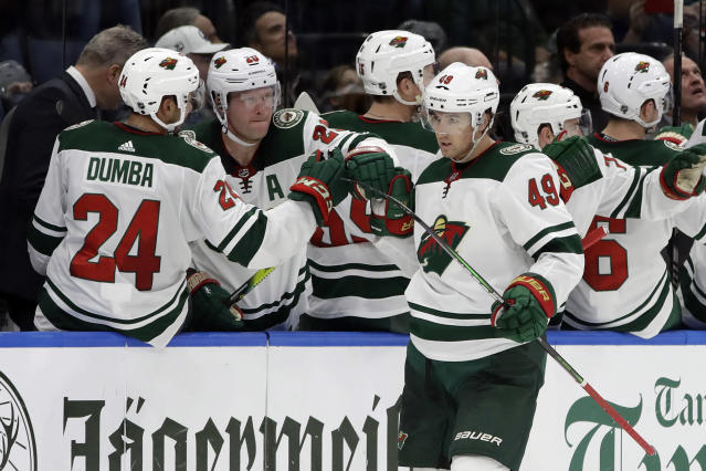 Minnesota Wild center Victor Rask (49) celebrates with the bench after his goal against the Tampa Bay Lightning during the second period of an NHL hockey game Thursday, Dec. 5, 2019, in Tampa, Fla. (AP Photo/Chris O'Meara)