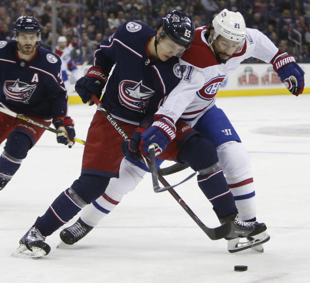 Montreal Canadiens' Nate Thompson, right, and Columbus Blue Jackets' Markus Nutivaara, of Finland, fight for the puck during the first period of an NHL hockey game Thursday, March 28, 2019, in Columbus, Ohio. (AP Photo/Jay LaPrete)