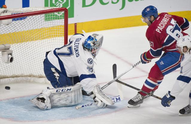 Montreal Canadiens' Max Pacioretty slides in on Tampa Bay Lightning's goaltender Kristers Gudlevskis during second period NHL Stanley Cup playoff action in Montreal, Tuesday, April 22, 2014. (AP Photo/The Canadian Press, Graham Hughes)