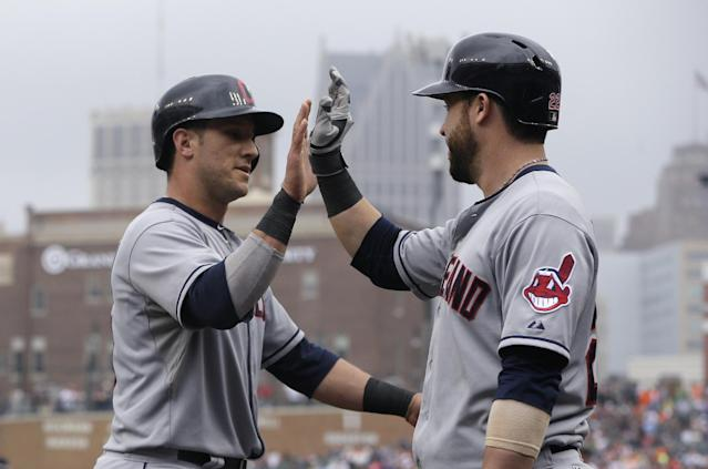 Cleveland Indians' Yan Gomes, left, is congratulated by Jason Kipnis after scoring on a single by teammate David Murphy during the ninth inning in the first baseball game of a doubleheader, Saturday, July 19, 2014 in Detroit. (AP Photo/Carlos Osorio)