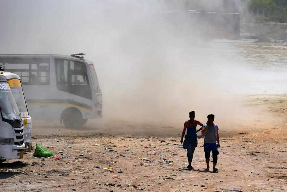 NEW DELHI, INDIA - JUNE 10: People seen during a dust storm in the afternoon near the banks of the river Yamuna on June 10, 2019 in New Delhi, India. The mercury shattered all records in Delhi NCR on Monday with parts of the national capital region recording an all-time high of 48 degrees Celsius for the month of June. (Photo by Amal KS/Hindustan Times via Getty Images)