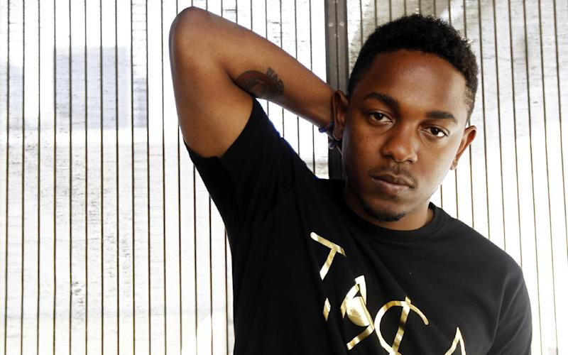 FILE - This July 2, 2011 file photo shows rapper Kendrick Lamar in Los Angeles. Lamar made a splash with his major label release, debuting No. 2 on Billboard's Top 200 behind Taylor Swift, and topped the rap charts with more than 241,000 copies sold. His album also generated 2.8 million streams through Spotify, the second highest first week output so far this year. (AP Photo/Matt Sayles, file)