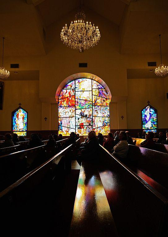 LOS ANGELES, CA:  Armenians celebrate Christmas mass at St. Garabed Armenian Apostolic Church against the backdrop of a stained glass window. File photo: 2011