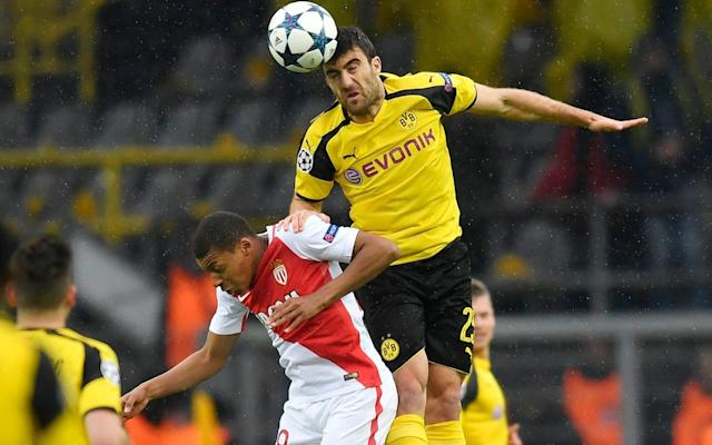 <span>Monaco's Kylian Mbappe, left, and Dortmund's Sokratis Papastathopoulos go for a header during the Champions League quarterfinal first leg soccer match between Borussia Dortmund and AS Monaco</span> <span>Credit: Martin Meissner/AP </span>