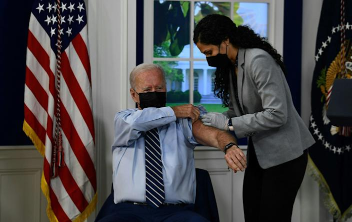 US President Joe Biden receives a third shot of the Pfizer Covid-19 vaccine as a booster on the White House campus September 27, 2021, in Washington, DC. (AFP via Getty Images)