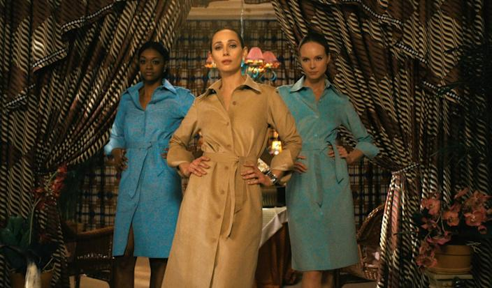 Three women modeling Ultrasuede shirtdresses in tan and turquoise