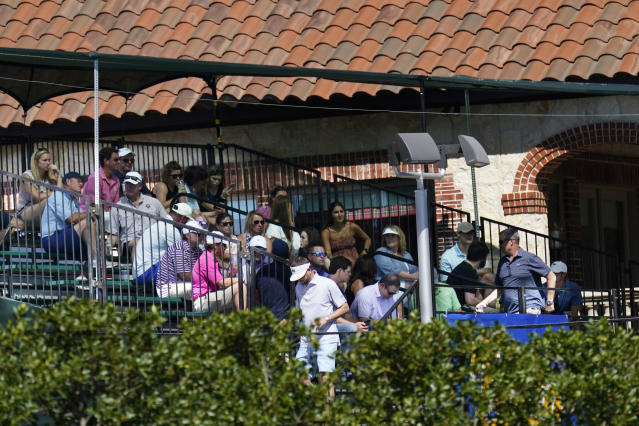 Fans sit in a grandstand outside the course overlooking the 15th fairway in order to watch the first round of the Charles Schwab Challenge golf tournament at the Colonial Country Club in Fort Worth, Texas, Thursday, June 11, 2020. (AP Photo/David J. Phillip)