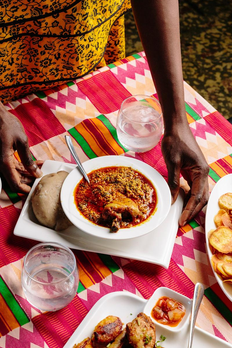 Adebajo getting ready to eat Iyan (pounded yam) with Egusi soup and chicken