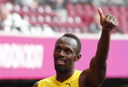 Athletics - World Athletics Championships - Men's 4x100 Metres Relay Heat 2 - London Stadium, London, Britain – August 11, 2017. Usain Bolt of Jamaica celebrates after Jamaica won the race. REUTERS/Fabrizio Bensch