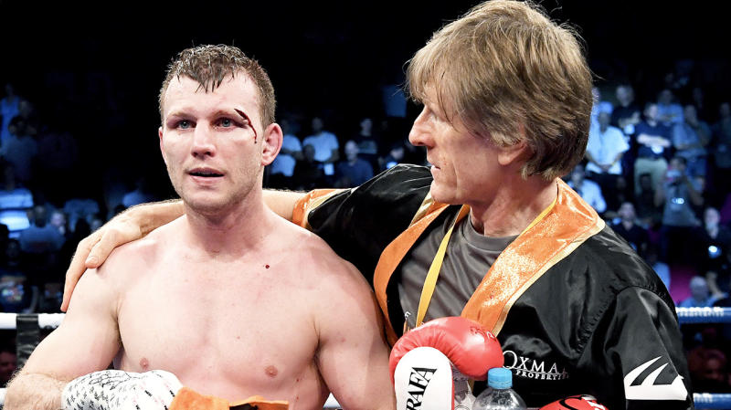 Jeff Horn (pictured left) after a fight and trainer Glenn Rushton (pictured right) celebrate.