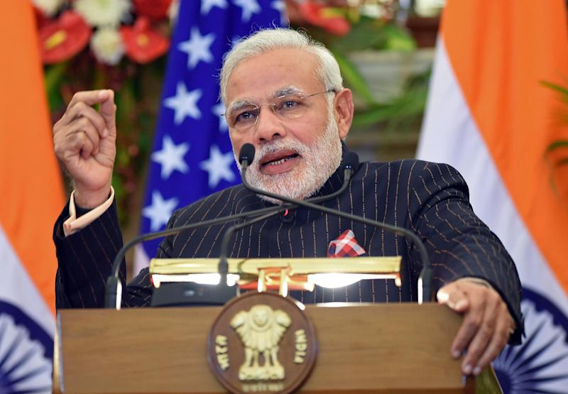 Indian Prime Minister Narendra Modi speaks during a joint press conference after delegation level talks with US President Barack Obama in New Delhi on January 25, 2015