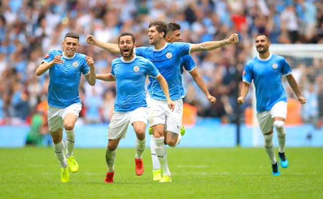 Manchester City players celebrate after winning the penalty shootout in the Community Shield match at Wembley Stadium, London. (Adam Davy/Getty)