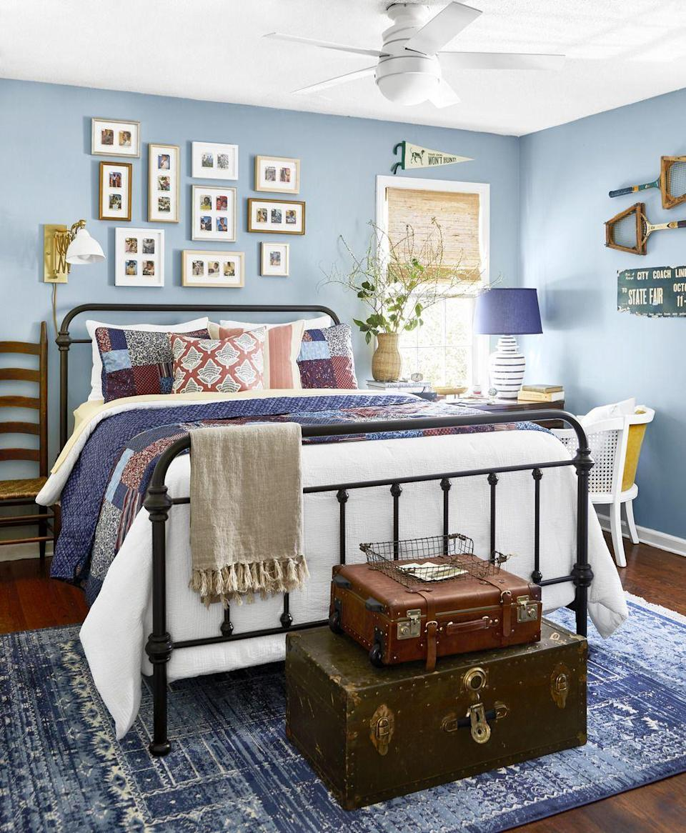 """<p>Victoria and Marcus Ford painted the walls of their main bedroom Dutch Tile Blue by Sherwin-Williams for a natural nod to the New England coast. The color also ties in beautifully with other nautical elements throughout the home. Passed-down knickknacks and furniture pieces give the space a collected, welcoming feel.</p><p><strong>Get the Look:<br></strong>Wall Paint Color: <a href=""""https://www.sherwin-williams.com/homeowners/color/find-and-explore-colors/paint-colors-by-family/SW0031-dutch-tile-blue"""" rel=""""nofollow noopener"""" target=""""_blank"""" data-ylk=""""slk:Dutch Tile Blue by Sherwin-Williams"""" class=""""link rapid-noclick-resp"""">Dutch Tile Blue by Sherwin-Williams</a></p>"""