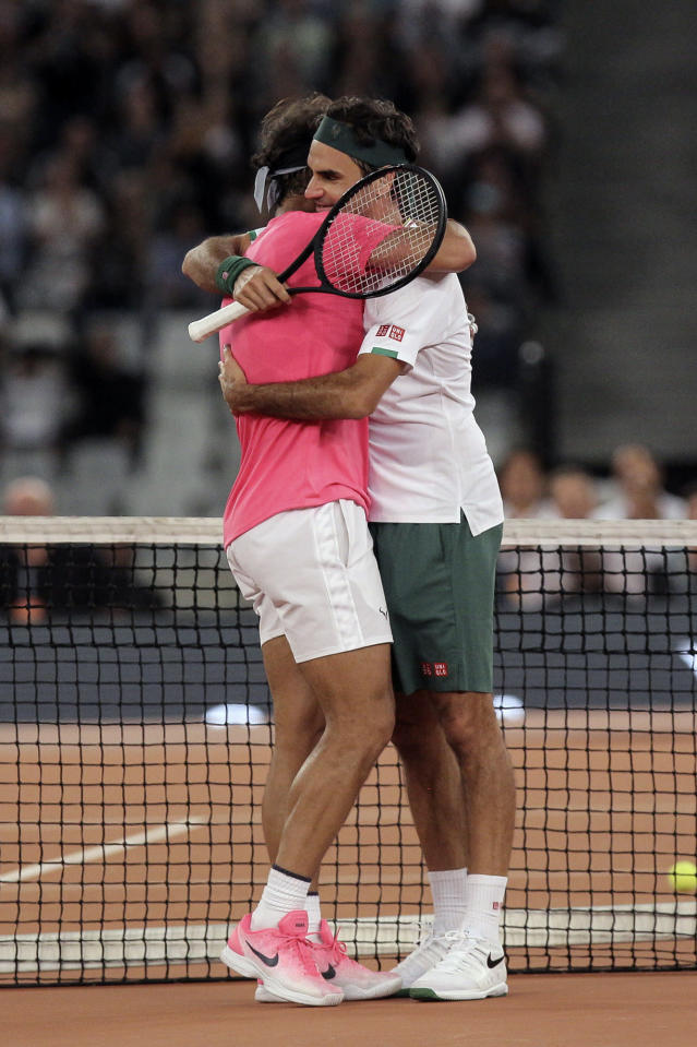 Roger Federer, right, and Rafael Nadal embrace after the final point of their exhibition tennis match held at the Cape Town Stadium in Cape Town, South Africa, Friday Feb. 7, 2020. (AP Photo/Halden Krog)