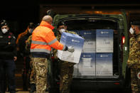 The vaccines for COVID-19 arrive at the military airport of Pratica di Mare, Saturday, Dec. 26, 2020, in Rome, Italy. The vaccines will be distributed in Italy's regions due to the coronavirus pandemic. (Cecilia Fabiano/LaPresse via AP)